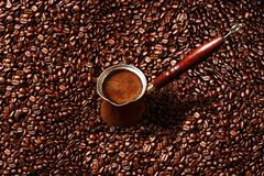 Hot coffee prepared in a Turk. - stock photo