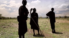 Maasai tribe standing on grassland Stock Footage