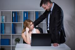 Businessman seducing assistant Stock Photos