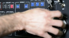 Operator working with control panel of CNC machining center rotating handle jog Stock Footage