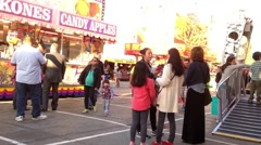 Candy apples booth at the West Coast Amusements Carnival Stock Footage