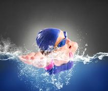 Swims in freestyle - stock photo