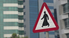 Middle East, pedestrian crossing, traditional dress, Doha, Qatar Stock Footage
