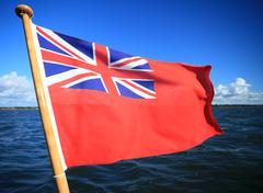 British maritime red ensign flag blue sky Stock Photos