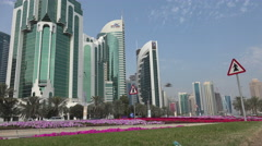 Qatar, Doha, road sign warns for pedestrians, West Bay area, city skyline Stock Footage