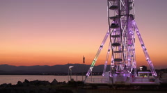 Lighted Ferris Wheel on the Coast in MARSEILLE, FRANCE Stock Footage
