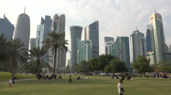 People visit a park in the West Bay area, Doha, Qatar Stock Footage