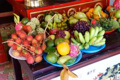 Offerings of fruit to fertility deity - stock photo