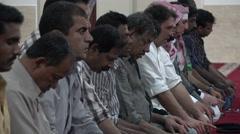Muslim men pray inside Doha mosque, Qatar Stock Footage
