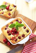 Fresly baked cherry sponge cakes in square casserole dishes Stock Photos