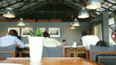 People drinking coffee and working at free work space Stock Footage