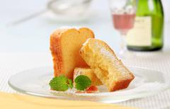 Slices of pound cake on plate - stock photo