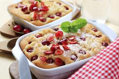 Cherry sponge cakes in ceramic casserole dishes Stock Photos