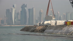 Stock Video Footage of Doha, Qatar, construction site, crane lifting concrete blocks