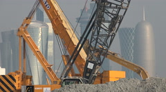 Qatar, Doha, cranes in front of city's skyline Stock Footage