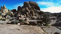 Joshua Tree National Park- Tilt Up Rock Edifice To Sky - stock footage