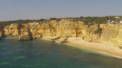 Aerial from the south coast at praia Marinha in the Algarve Portugal Stock Footage