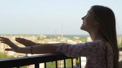 Young Teen Girl Enjoying Life Standing On Balcony HD Stock Footage