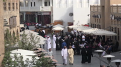 Tourism in Qatar, people visit popular Souq Waqif market bazaar in Doha - stock footage