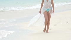Legs of an beautiful woman walking on the sandy Maldives beach. Slow motion. - stock footage