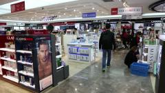 Shoppers at a duty free shop  at Incheon Airport, South Korean - stock footage