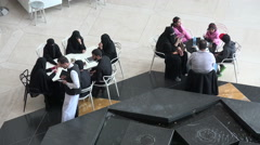 Visitors order food in Museum of Islamic Arts cafe, Doha, Qatar Stock Footage