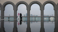 Doha skyline, Museum of Islamic Art, Arab couple take photos Stock Footage