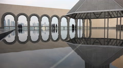 Doha, people visit the Museum of Islamic Art Stock Footage