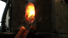 Glowing iron or steel coming out from oven in the smithy.Hot metal falling down. Stock Footage