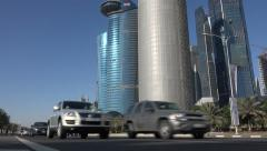 Traffic drives past Doha's iconic skyline Stock Footage