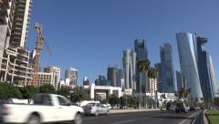 Traffic drives towards West Bay in Doha, Qatar. Stock Footage