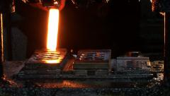 Blacksmith in dark smithy working with hot metal. Mechanical hammer punching. Stock Footage