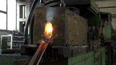 Hot metal coming out from oven in the smithy. Glowing iron or steel fall down. Stock Footage