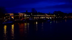 Amsterdam at the Amstel by night in the Netherlands Stock Footage
