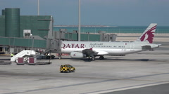 Qatar Airways plane at gate of Hamad International Airport in Doha Stock Footage