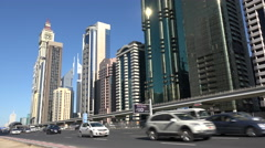 Dubai skyline, rush hour traffic, financial and business district Stock Footage
