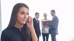 Selective focus on young dark-haired beautiful smiling woman speaking on phone Stock Footage