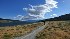 New Zealand Lake Dunstan runner on path between fields Stock Footage