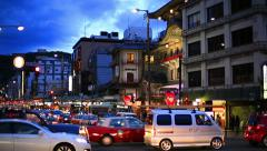 People and cars cross the intersection in Kyoto in time lapse on April 01, 2015. Stock Footage
