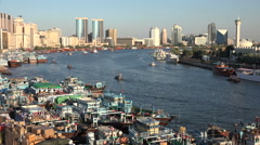 Dubai, Deira port, skyline, dhow vessels, cargo transport, harbor - stock footage
