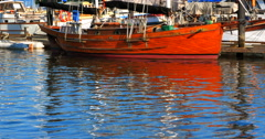 4K Wooden Boat Hull, Calm Water, Reflection Stock Footage
