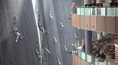 Dubai Mall, 'divers' jump along 'The Waterfall' Stock Footage