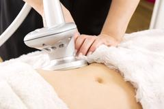 Slimming and cellulite laser treatment at clinic - stock photo