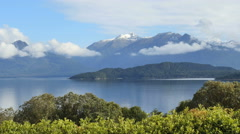 New Zealand Lake Manapouri island under low clouds Stock Footage