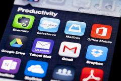 Close-up image of an iPhone screen with icons of productivity apps Stock Photos