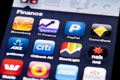 Close-up image of an iPhone screen with icons of finance apps Stock Photos
