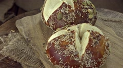 Pretzel Rolls with seeds (not loopable) Stock Footage