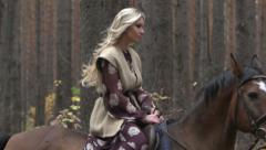 Rider on horseback in the woods Stock Footage
