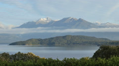 New Zealand Lake Manapouri clouds separate mountains and island Stock Footage