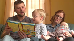 Family Reads the Jesus Storytime Bible Together Stock Footage